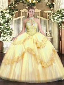 Suitable Gold Ball Gowns Halter Top Sleeveless Tulle Floor Length Lace Up Appliques and Sequins Sweet 16 Quinceanera Dress