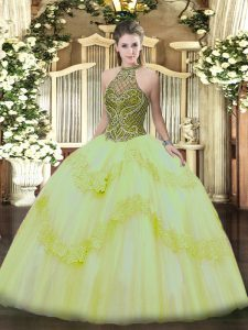 Nice Light Yellow Ball Gowns Halter Top Sleeveless Tulle Floor Length Lace Up Beading and Appliques Quinceanera Gowns