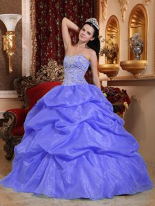 Multi-tiered Blue Sweetheart Dresses for a Quince in with Beading
