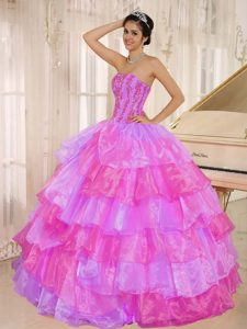 Pink and Lilac Quinceanera Dress with Ruffled Layers and Appliques